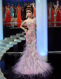 """OOAK Barbie NiniMomo's Miss Maine 2013 ~ From the Northeast corner of the US, Vacationland, sends this elegant & sexy beauty in an exquisite evening gown inspired by the gown worn by Miss India Universe 2013. Sheer, pink, 100% silk organza sleeveless dress. Hair has been custom heat permed along ends & worn in a high flip pony adorned w/ a barrette of mixed gold & silver metallic beads 