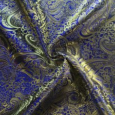 "Metallic Paisley Brocade is 60"" inches wide and 100% polyester. This fabric is available in 9 colors and sold by the yard. This wonderful brocade is perfect for your home decorations, apparel, table c"