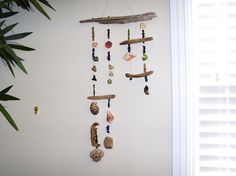 Seashell and driftwood wind chime wall art. $49.00, via Etsy.