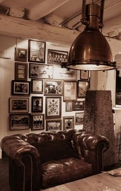 Perfect Man space.  Great sofa chair, industrail light, and vintage sports photos on the wall.