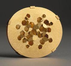 Christel van der Laan -  Brooch: Reflex, 2006. Gold plated sterling silver.