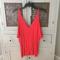 Summer Sale!! ☀️ Rachel Pally red tank top Rachel Pally red tank top deep v in front and back (excuse my model in just had a baby!) also would recommend a cute lace bralet with this Rachel Pally Tops Tank Tops