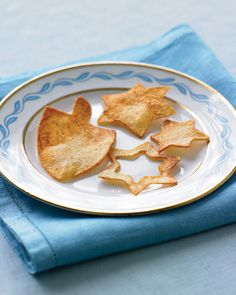 For a shapely twist on potato latkes, make potato chips in the forms of stars, dreidels, and other designs. Use a mandoline to thinly slice peeled potatoes lengthwise. Soak slices in cold water to prevent discoloration. Pat dry with paper towels; use cookie cutters to cut shapes. Heat vegetable oil in a pot to about 360 degrees. Working in small batches, deep-fry chips until golden brown, about 3 to 4 minutes. Drain chips on paper towels, sprinkle with salt, and serve immediately.
