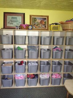 This would be a great idea for atic to store hand me downs and new clothes n. But all tops on totes and labeled by size