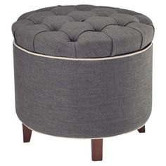 Storage ottoman with a tufted top.     Product: Storage ottoman        Construction Material: Wood and linen...