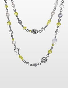 Beads of lemon citrine, peridot, rock crystal, pearls, moon quartz, and sterling silver make for an eclectic, textured necklace.