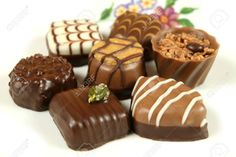 4890655-Expensive-assorted-chocolates-Delicious-truffles-and-pralines-Sweets-assortment--Stock-Photo.jpg (1300×866)