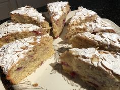 Raspberry Bakewell Cake This is a Rachel Allen recipe. 150 g butter, softened 150 g caster sugar 2 eggs, few drops of almond essence ,50 ml milk, 150 g self-raising flour 150 g ground almonds 150 g fresh or frozen raspberries 25 g flaked almonds. Grease & line 20 cm cake tin with 6 cm sides. Heat oven to 160 fan. Cream butter and sugar, beat in eggs, essence & milk, fold in flour & ground almonds, add raspberries. Scatter over flaked almonds, bake for 50 -55 mins.