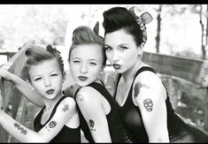 Rockabilly/pinup for decade day at school. Red lipstick, fake tats, bandana, tank, skinny jeans