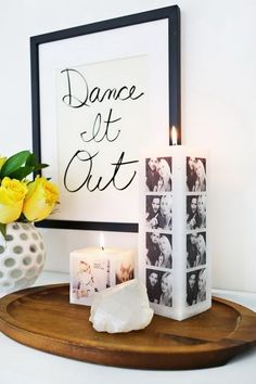 DIY Decorative Photo Candles. Transfer the photos onto the candles using an embossing gun with a wax paper barrier in between. Inexpensive, easy to put together, and make the easiest gift!
