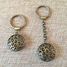 Bronze Orb Keychain Key Ring. Bronze Bubble Keychain / Bronze Orb Key Ring / Mens Bubble Key Chain / Bronze Orb Keychain / Mens Key Rings / Mens Keychains A bronze hollow bubble charm keychain. You have your choice of key chain and charm only: 2 1/2 inches long key chain with charm and rolo chain: 3 1/2 inches long. • Hangs from bronze plated brass chunky rolo chain that has been soldered for strength and lengthy ownership. • Rolo chain is wide enough to add more keyrings to fit your...