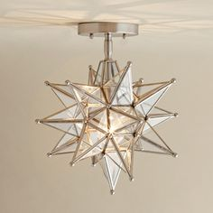 A symbol of warmth and welcome, the Moravian star is a popular porch light. Traditionally clad in dark metal and dangling from a chain, this updated model has a shiny finish and semi-flush-mount styling.    Moravian Star Ceiling Light in Nickel, about $179; shadesoflight.com