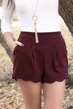 "Scallop bottom shorts in burgundy Model is 5'7"" and wearing a size Small"