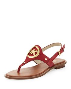 Red leather with golden hardware.Thong strap with logo medallion.Adjustable ankle strap.Flat heel.Rubber sole.Imported. #Fashion  #NeimanMarcus