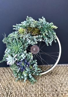 I could wax poetic about this wreath! Succulents are just the most beautiful plants! So many shades and textures! A frosted succulent garland drapes over a vintage bike wheel and is accented with a variety of succulents and air plants. All materials used are artificial! Hooray,