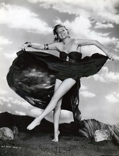 Moving freely for a shoot, as appose to posing for one,  might create such lively photography. Rita Hayworth - Affair In Trinidad (1952)