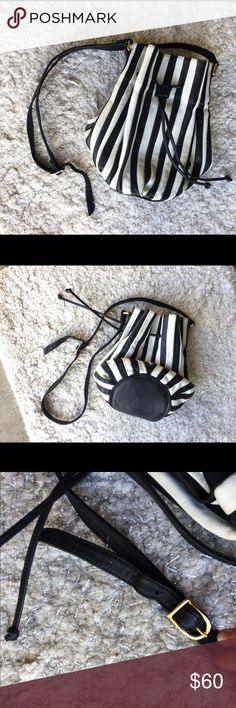 Brio Vintage 80s Black & White Leather Bucket Bag This is a rare vintage bucket bag - SO trendy right now - great condition for vintage - inside has a little attached coin purse - leather black and white - Brio Bags