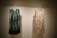Sonia Delaunay Exhibition at Thyssen Museum. Two visitors look at two ' Vestidos' (Dresses)
