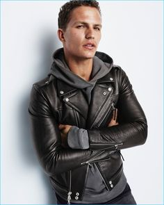 Nathaniel Visser rocks a leather biker jacket and sweatshirt from John Elliott for Gap x GQ's Best New Menswear Designers in American All-Stars limited-edition collection.