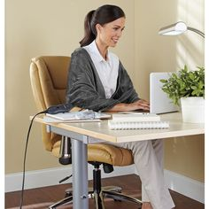 Jesus, your office is frigid. Wouldn't it be nice to be as smug as this lady, clad in her heated wrap?