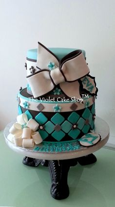 21st Birthday in Tiffany Blue with Bows - Big dramatic bow on top tier was inspired by rava aka Sweet Picasso on FB.  Unconventional argyle pattern on bottom tier was inspired by a photo in a fashion magazine.  Tiffany blue is the birthday girl's favourite colour and I thought it would go well with white and shades of gray.  TFL.