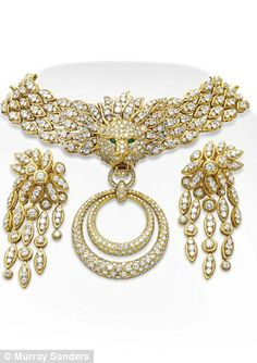 The Granny Suite is a stunning diamond and gold set, with emerald-eyed lion symbol and drop earrings. Elizabeth Taylor.
