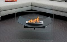 Bio-Blaze Bio-Ethanol Fireplaces Have you ever dreamed of fire without the nasty aftermath? Bio-Blaze makes fireplaces from bio-ethanol, which means no chimney, no electricity, no gas, and no smoke! These dirt-free fires will blaze in any number of spaces—in your backyard, on your tabletop, in a box attached to your wall. ToMo doesn't promote pyro-mania but... these are pretty slick.