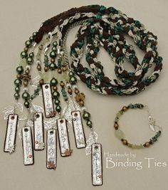 Handfasting cord in green, brown and cream with stamped aluminium, leather, glass pearls, silver leaves and gemstones
