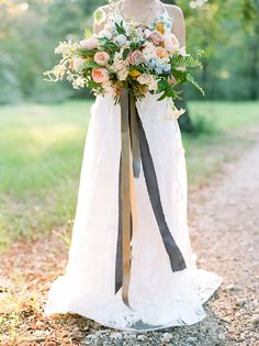 Texas Summer Wedding with a Colorful Bouquet https://heyweddinglady.com/rustic-elopement-peach-summer-blue/ #wedding #weddings #weddingideas #elopement #engaged #summerwedding #bride #weddingdress #weddingdresses #colorful #bouquet #bridalbouquet