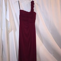 One-Shoulder Long Formal Dress Beautiful ruffle rose detail. Maroon. Fully lined with light padding built-in. Worn once. In perfect condition. Size 8. Enfocus Studio Dresses Prom