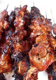 Philippine Style Pork or Chicken BBQ  -  marinating  overnight is the key to the most flavorful meat.  It's then skewered and grilled and basted, basted, basted to perfection.