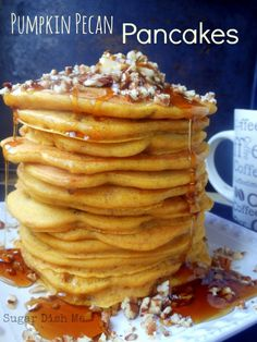 Easy from-scratch totally fluffy Pumpkin Pecan Pancakes. You'll love this recipe!
