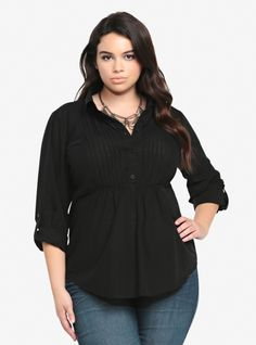 Soft and effortless, this black cotton shirt is detailed with flirty tuxedo-inspired pintucks and button tab long sleeves. With an empire waist and a collar, the half button-down shirt is in a sexy shadow stripe print.
