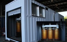 Shipping containers store batteries that stabilize loads on power grids.