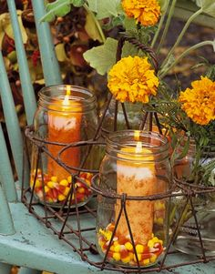 Mason Jar painted pumpkin | Fill mason jars with extra candy corn and a pillar candle .Then set ...