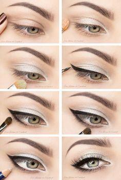 Maquillaje plateado con delineado negro.