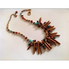 Love this bib necklace of lapis, turquoise, malachite, and coral pebbles set among golden sponge coral sticks designed and fabricated by Alexandra Marshall for Petite Bijoux Chic Wearable Art. $139.