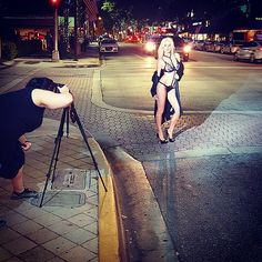 @nataliesng was stopping traffic downtown #fortlauderdale last night. Literally giving our insta following and locals an #exclusive #sneakpeek. #lingerieinthestreets #laceteddy #trenchcoat #photoshoot #drawingacrowd. Hair and makeup by @twochicksandsomelipstick