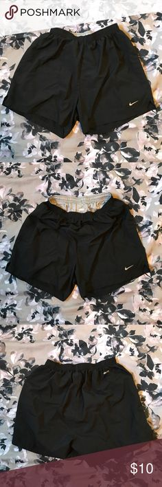 Nike running shorts Size small woman's  Nike running shorts with adjustable waste band. Nike Shorts