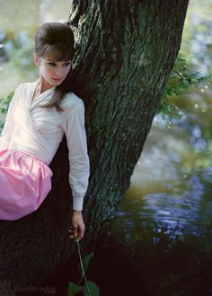 Audrey Hepburn at the river by her villa just outside Paris, 1962. She lived there renting the place while filming Paris When ...