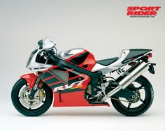 Honda RVT1000R, also known as the RC51. This picture is a 2002 model, SP-2 variant. I've lusted after this bike for over ten years. Its 999cc V-Twin engine gives it a sound not expected from a 'crotch rocket', and it's a true race bike. It's built for twisties and turns, and has way more class than the average squid burnout bike. Must have.