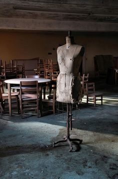 Mother figure. A sewing figure standing in a forgotten religion classroom by Desolate Places
