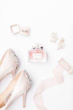 Beautiful light and airy wedding flatly with details of Miss Dior perfume bottle, heals, and elegant earrings. Every brides dream ! Wedding Ring Photography, Light Photography, Our Wedding Day, Wedding Bands, Green Wedding, Wedding Things, Wedding Timeline, Wedding Photos, Wedding Planning List