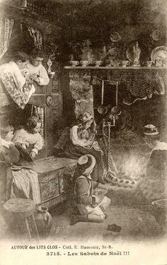 Les sabots de Noël !!! Dans une maison de Bretagne une mère entretient le feu dans la cheminée, les sabots des petits alignés sur l'âtre, les enfants dans le lit clos regardent (from http://mercipourlacarte.com/picture?/1454/)