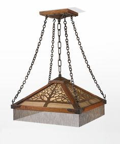 Gustav Stickley AN IMPORTANT AND RARE CHANDELIER, MODEL NO. 600 impressed with firm's early mark oak, hand-wrought copper, hammered antique glass covered with brass wire cloth, patinated wrought-iron chain and brass fringe 35 1/2 x 24 1/8 x 24 1/8 in. (90.2 x 61.3 x 61.3 cm) circa 1905 executed by the Craftsman Workshops of Gustav Stickley, Eastwood, NY