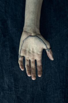 Rings by Murky.  When i die my body does not die with me. It awaits and transforms with the spreading paleness of stiffness. Like an arctic winter landscape each day draws closer and closer to the state of frozen. The process of rigidity does not subdue until the final state in reached: stillness. The body remembers its movement.