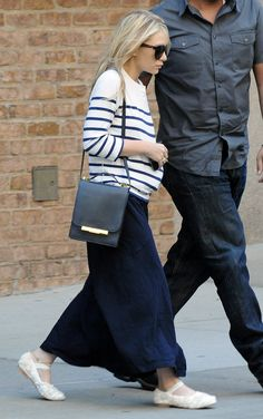 Not high on most of the ensemble, but that bag (from The Row's new bag collex) is so chic!