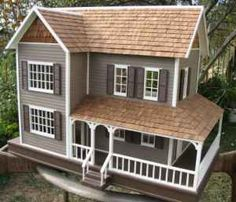 This is just like the Duracraft Farmhouse Dollhouse that my dad built for me except that mine's exterior was never painted. Probably the best Christmas gift of my growing up years.:)