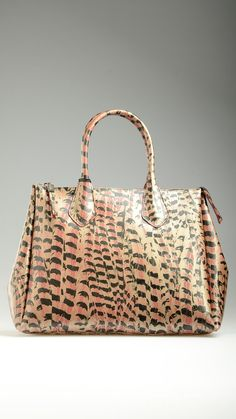 Feather print embellished pvc tote bag in pink and dark chocolate tones, top zip, tote handles, silver hardware, 15.7'' x 8.2'' x 11.8'', 100% pvc.