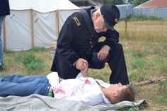 Civil War in Roy:  A chaplain recites the Lord's Prayer to a young soldier during the Civil War reenactment.